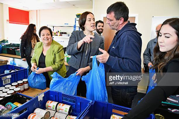 Labour leader Kezia Dugdale and Public Services spokesperson Jackie Baillie help staff and volunteers pack food bags for distribution at a community...