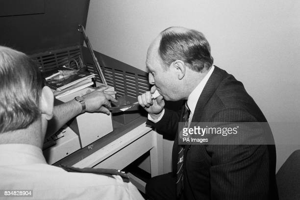 Labour leader Neil Kinnock tries out a breathalyser machine during his visit to the Halifax Divisional Police Headquarters