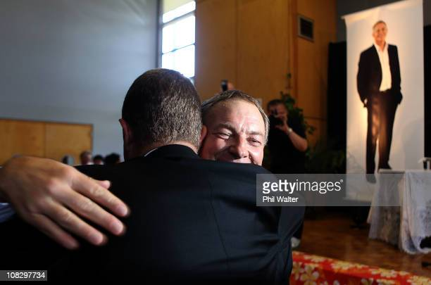 Labour leader Phil Goff hugs a colleague after delivering his party's State of the Nation Speech at the New Lynn Community Centre on January 25, 2011...