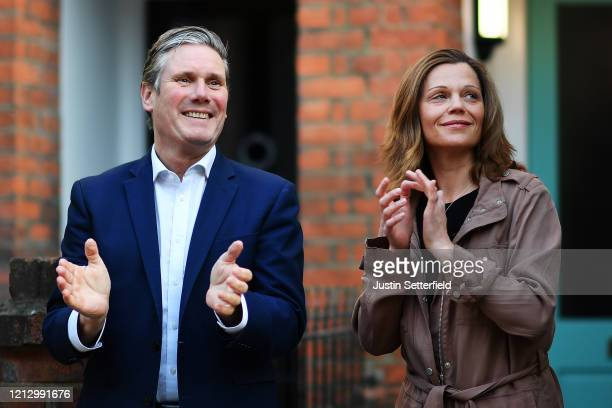 Labour leader Sir Keir Starmer and his wife Victoria Starmer applaud for key workers outside his home on May 14, 2020 in London, England. Following...