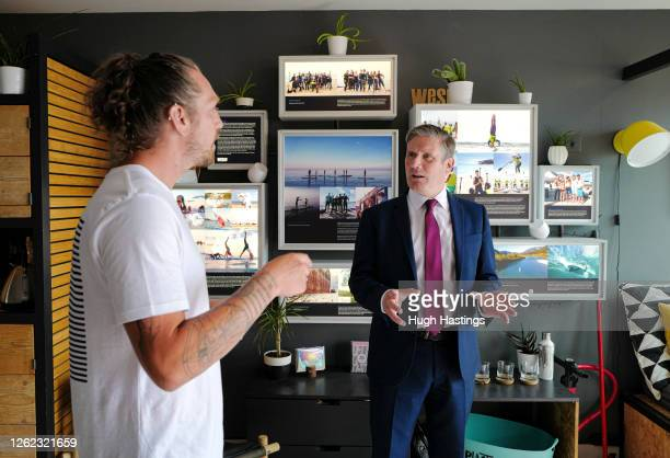 Labour Leader Sir Keir Starmer during a visit to the beachside WeSup Paddle Boarding outlet where he spoke to local business coowner Harry JamesMills...