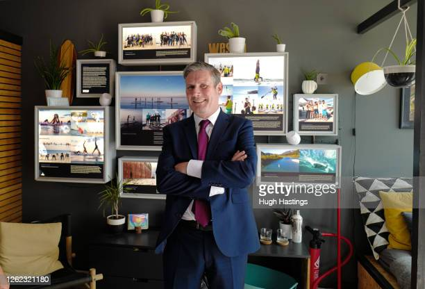 Labour Leader Sir Keir Starmer poses for the photographer during a visit to the beachside WeSup Paddle Boarding outlet where he spoke to local...
