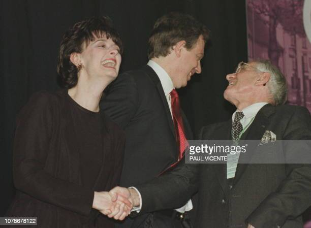 Labour leader Tony Blair and wife Cherie are congratulated by father Leo after Blair returned his seat at the Sedgefield constituency 02 May after...