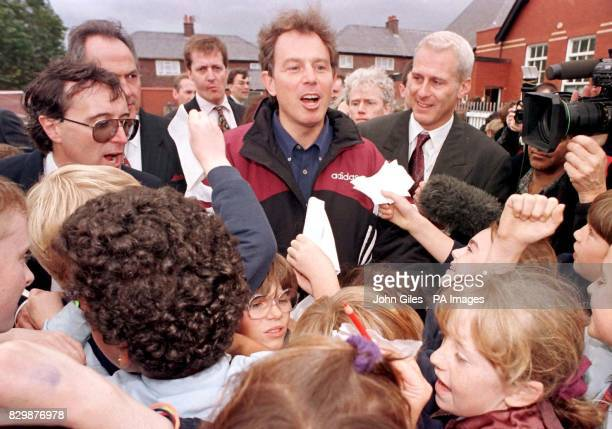 Labour leader Tony Blair is mobbed by young schoolchildren during a visit today to Devonshire Road primary school in Blackpool where he joined...