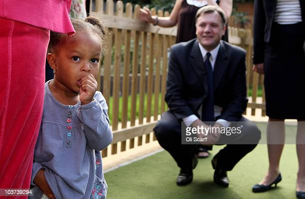 Labour leadership candidate Ed Balls fails to attract the attention of Eden aged 2 during a visit to a housing estate in Bermondsey on August 31 2010...