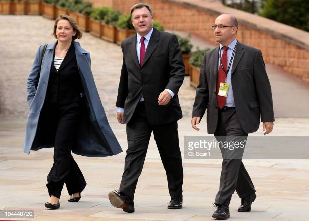Labour leadership contender Ed Balls arrives with his wife Yvette Cooper and colleague Jim Knight for the annual Labour Party Conference on September...