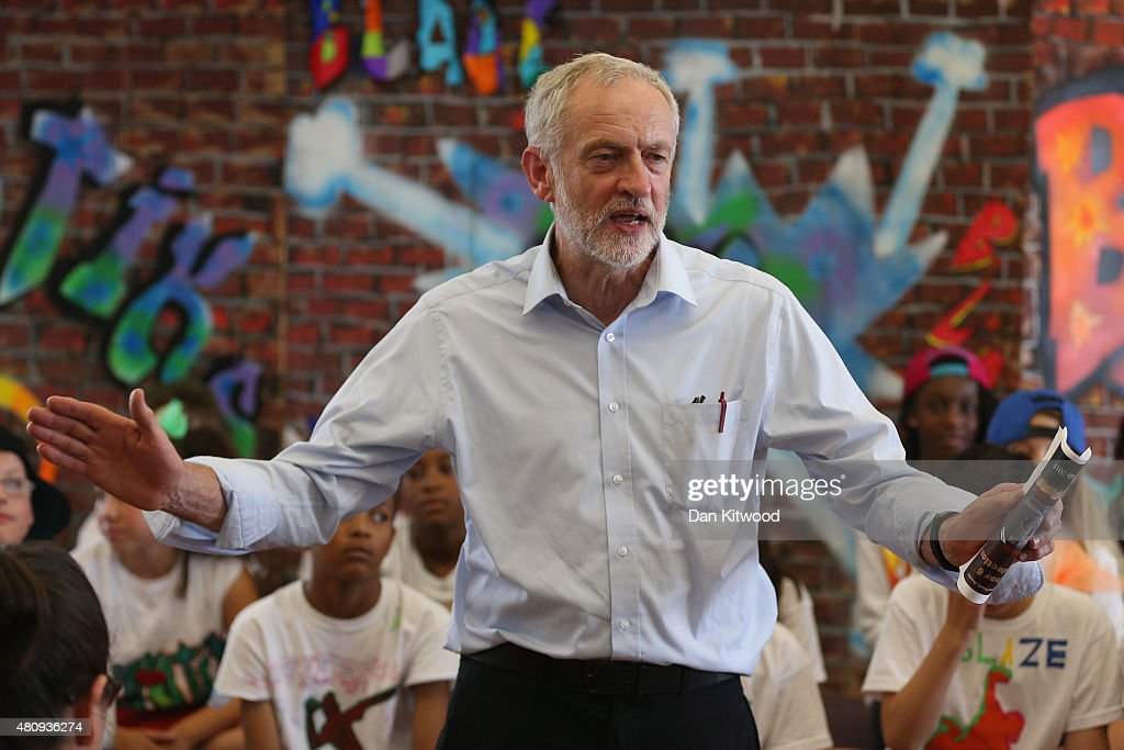 Labour leadership contender Jeremy Corbyn presents pupils with certificates after they perform in a play on their last day of school at Duncombe Primary School on July 16, 2015 in London, England. Jeremy Bernard Corbyn is a British Labour Party politician and has been a member of Parliament for Islington North since 1983. He is currently a contender for the position as leader of the Labour Party.