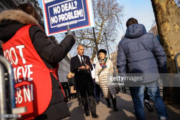 Labour MP Chuka Umunna and Conservative MP Anna Soubry pass a proBrexit protester after leaving the the Cabinet Office following a Brexit meeting...