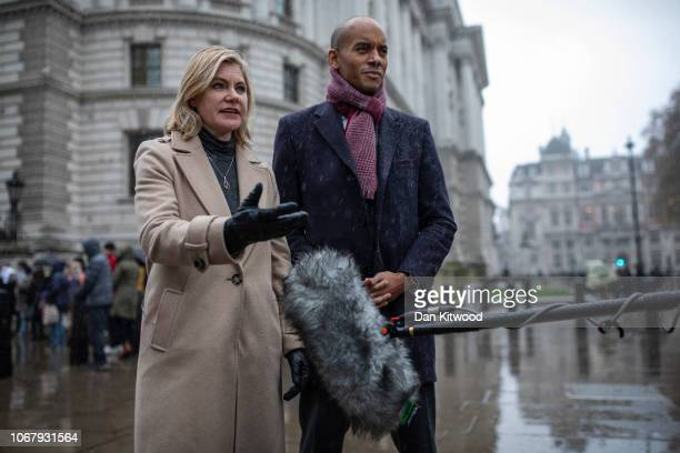 Labour MP Chuka Umunna and Conservative MP Justine Greening are interviewed in the pouring rain before handing in a petition to Downing Street...