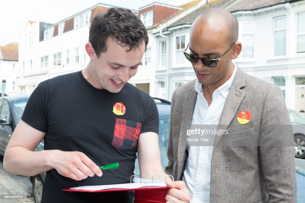 labour mp chuka umunna talks to a party member as he visits local