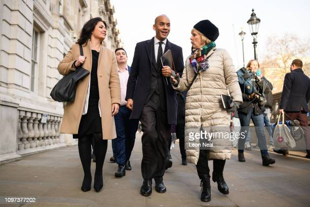 Labour MP Chuka Umunna walks with Conservative MPs Heidi Allen and Anna Soubry as they leave the Cabinet Office following a Brexit meeting with...