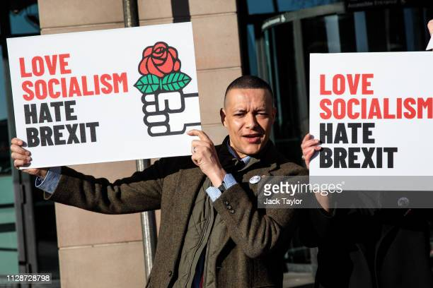 Labour MP Clive Lewis holds a placard during a demonstration by Labour MPs against Brexit outside Portcullis House on March 5 2019 in London England...