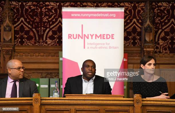 Labour MP David Lammy speaks as Guardian reporter Amelia Gentleman looks on during a meeting with representatives of the Windrush generation at the...