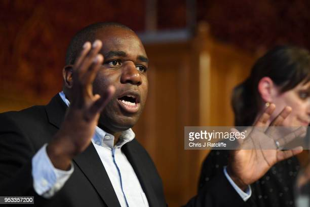 Labour MP David Lammy speaks during a meeting with representatives of the Windrush generation at the House of Commons on May 1 2018 in London England...