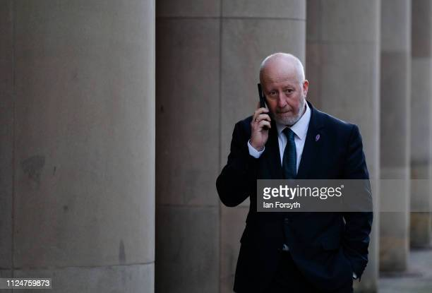 Labour MP for Middlesbrough Andy McDonald speaks on his phone as party leader Jeremy Corbyn conducts media interviews as he visits Middlesbrough...