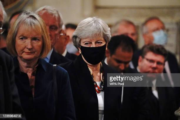 Labour MP Harriet Harman former Prime Minister Theresa May attend a service to honour Sir David Amess at St Margaret's church on October 18, 2021 in...