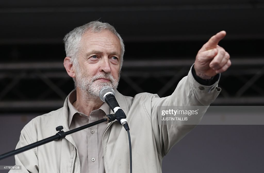 Labour MP Jeremy Corbyn speaks to protesters following a march against the British government's spending cuts and austerity measures in London on June 20, 2015. Thousands of demonstrators staged an anti-austerity march in London today, in the first major public protest since Conservative Prime Minister David Cameron won a general election. TALLIS