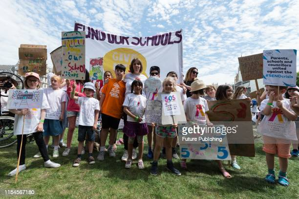 Labour MP Jess Phillips and her 10yearold son Danny join hundreds of school children their parents and campaigners from across the country in...