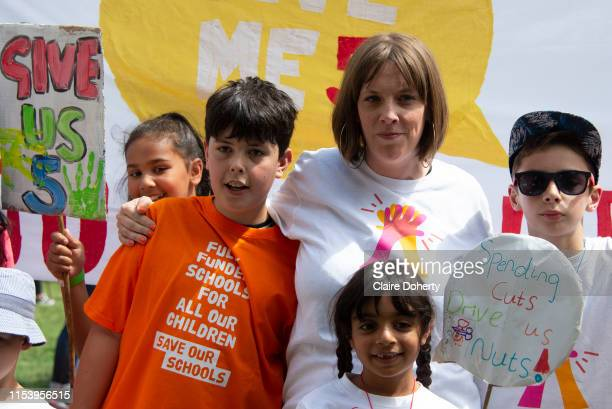 Labour MP Jess Phillips and son Danny join school children during a protest in Parliament Square in London United Kingdom on 5th July 2019 Campaign...