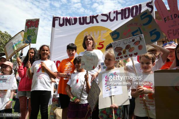Labour MP Jess Phillips attends a protest with her son Danny over schools being forced to close early on Fridays from September because of funding...