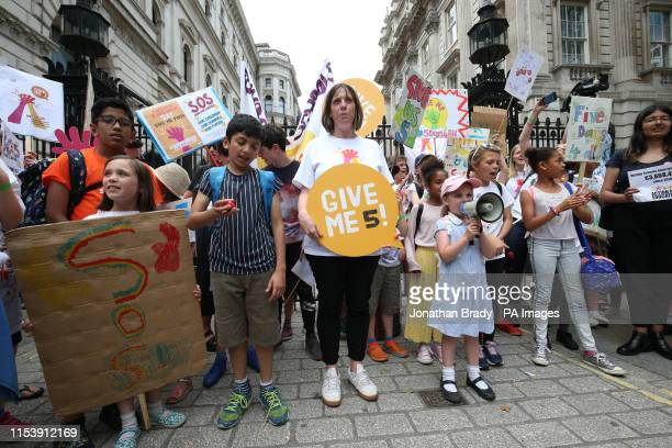 Labour MP Jess Phillips joins a protest over schools being forced to close early on Fridays from September because of funding cuts make their way to...