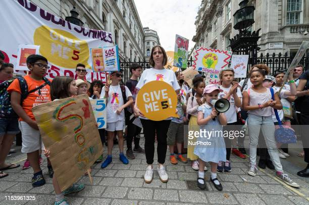 Labour MP Jess Phillips joins hundreds of school children their parents and campaigners from across the country outside Downing Street for a protest...