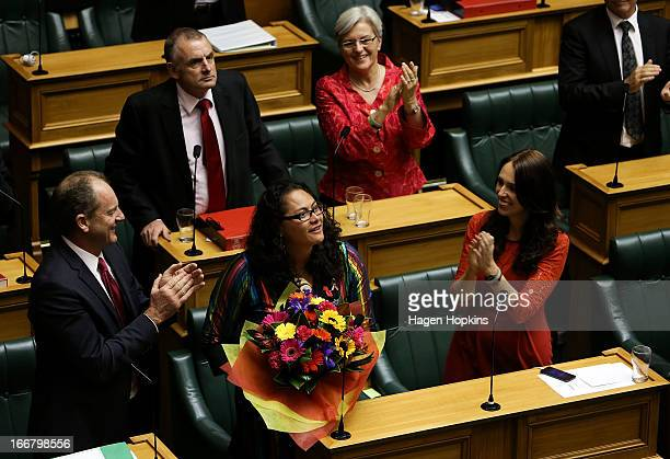 Labour MP Louisa Wall is applauded by fellow Labour MPs from left, David Shearer, Trevor Mallard, Maryan Street and Jacinda Ardern after the third...