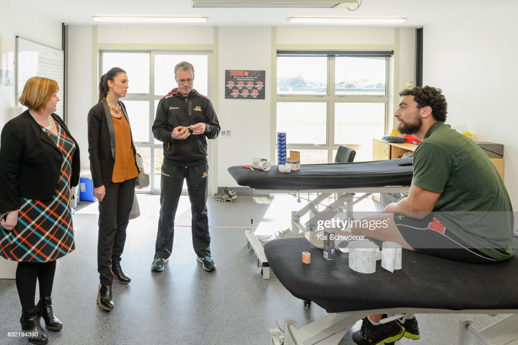 Labour MP Megan Woods, Labour Leader Jacinda Ardern, Canterbury Physiotherapist John Roche and Alex Hodgman of Canterbury (L-R) look on during a visit at Canterbury Rugby on August 16, 2017 in Christchurch, New Zealand. The Labour party has pledged $10 million towards mental health support for children in Canterbury and Kaikoura to help overcome the trauma of earthquakes, with plans to fund an extra 80 mental health professionals over the next three years who will work in all public primary and intermediate schools.