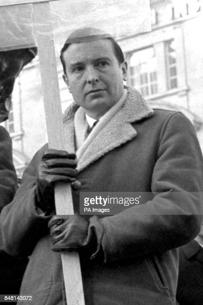 Labour MP Peter Archer who is interested in overseas aid pictured with a placard at the base of the Eros statue in Piccadilly Circus London when he...