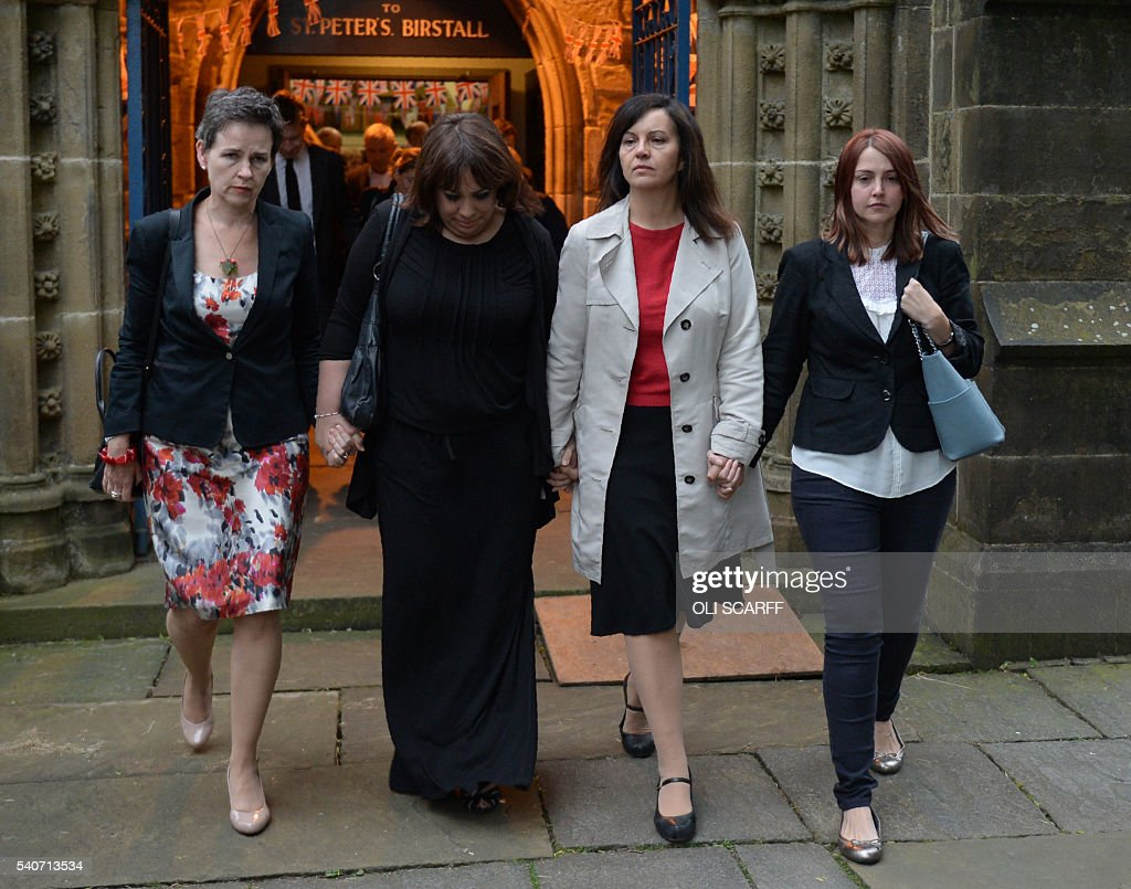 Labour MP's Mary Creagh (L) and Caroline Flint (2R) leave St Peters church in Birstall after attending a vigil to slain Labour MP Jo Cox on June 16, 2016. Cox died today after a shock daylight street attack, throwing campaigning for the referendum on Britain's membership of the European Union into disarray just a week before the crucial vote. SCARFF