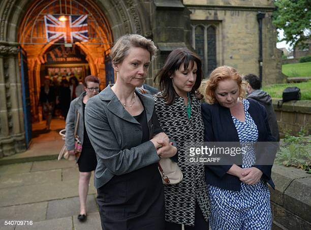 Labour MP's Yvette Cooper and Rachel Reeves leave St Peters church in Birstall after attending a vigil to slain Labour MP Jo Cox on June 16 2016 Cox...