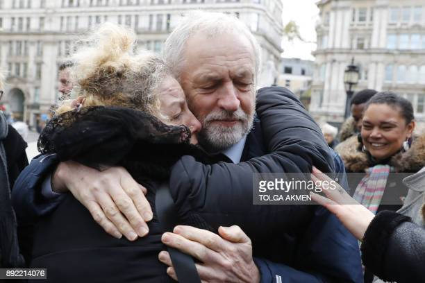 Labour opposition party leader Jeremy Corbyn consoles a mourner as they leave St Paul's cathedral after participating in a Grenfell Tower National...