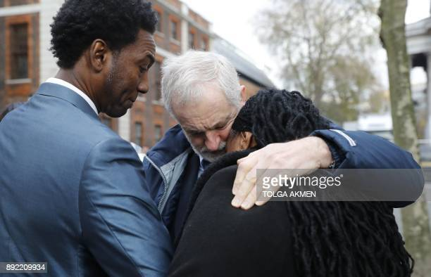 Labour opposition party leader Jeremy Corbyn consoles a relative of a victim as they leave St Paul's cathedral after participating in a Grenfell...