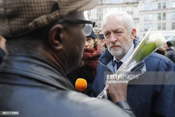 Labour opposition party leader Jeremy Corbyn speaks with a mourner as they leave St Paul's cathedral after participating in a Grenfell Tower National...