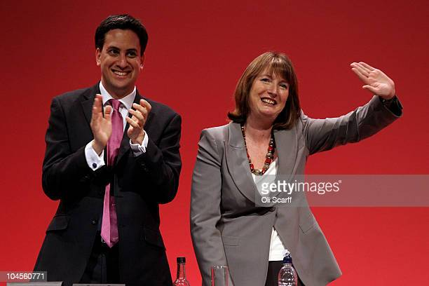 Labour party leader Ed Miliband and deputy leader Harriet Harman wave to delegates at the end of the Labour party conference on September 30 2010 in...