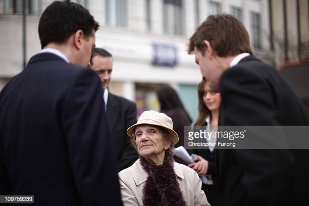 Labour party leader Ed Miliband and newly elected Barnsley MP Dan Jarvis talk to resident Violet Booth aged 90 during a walkabout after last nights...