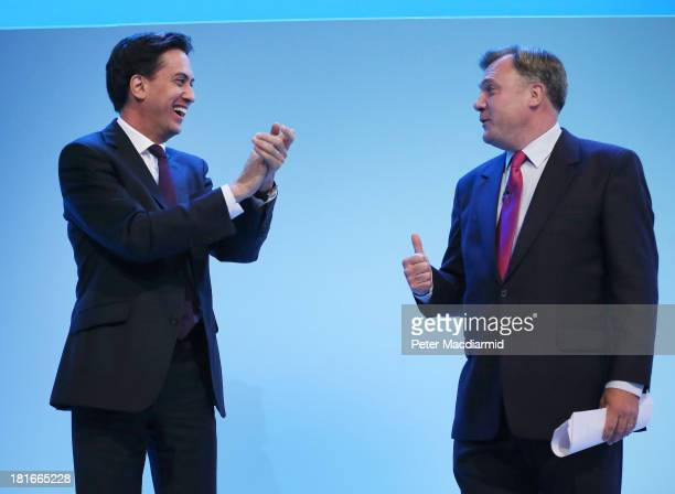 Labour Party leader Ed Miliband applauds Shadow Chancellor Ed Balls after he addressed the Labour Party conference on September 23 2013 in Brighton...