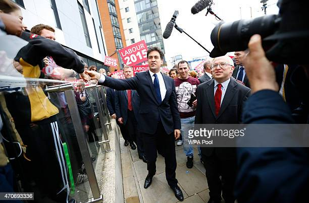 Labour Party leader Ed Miliband greets supporters as he arrives at a campaign event on April 22 2015 in Ipswich United Kingdom Britain goes to the...