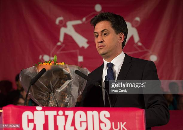 Labour party Leader Ed Miliband is given flowers as he arrives to speak at the Citizens UK event at Westminster Central Hall on May 4 2015 in London...