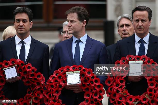 Labour Party leader Ed Miliband Liberal Democrat leader Nick Clegg and Prime Minister David Cameron prepare to place a wreath during a tribute at the...