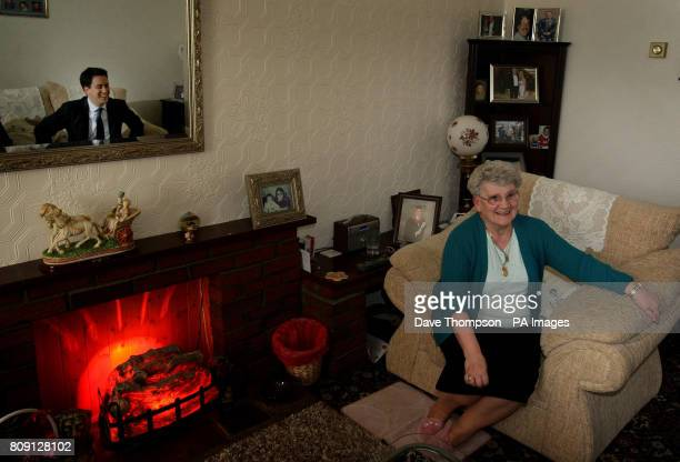 Labour Party Leader Ed Miliband meets 78yearold resident Doreen Chadwick during a visit to a council estate in the Collyhurst area of Manchester