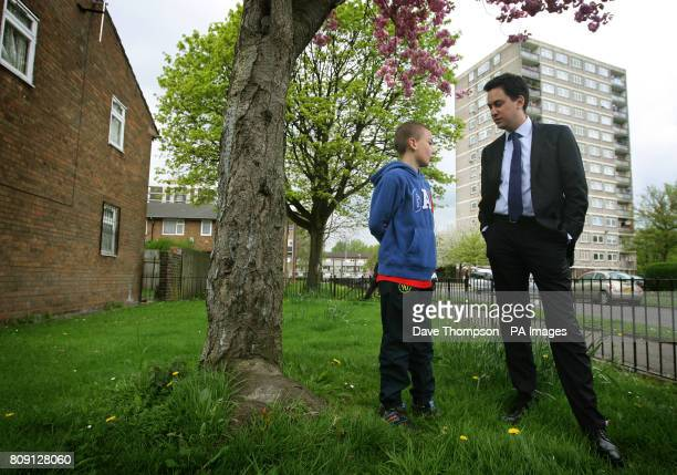 CROP Labour Party Leader Ed Miliband meets Bradley Corby aged 9 during a visit to a council estate in the Collyhurst area of Manchester