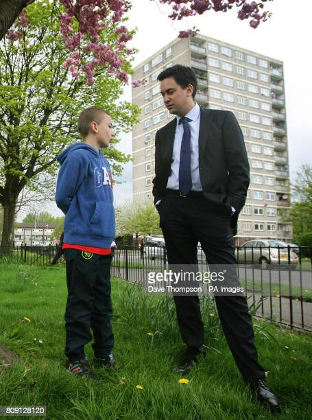 Labour Party Leader Ed Miliband meets Bradley Corby aged 9 during a visit to a council estate in the Collyhurst area of Manchester