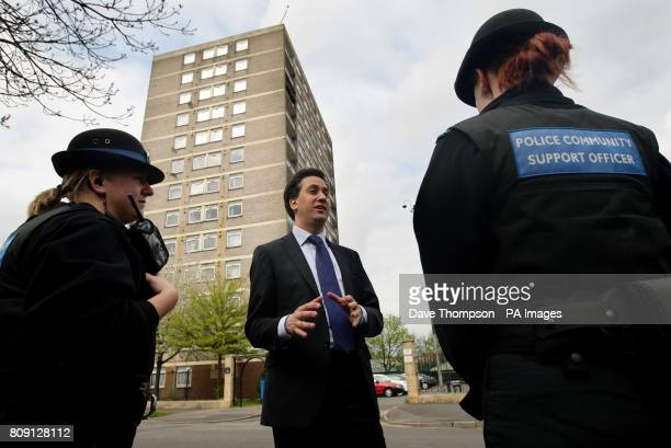 Labour Party Leader Ed Miliband meets local Police Community Support Officers during a visit to a council estate in the Collyhurst area of Manchester