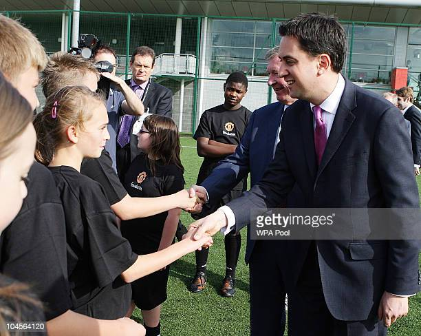 Labour Party leader Ed Miliband meets members of the Manchester United academy at the club's Carrington Training Ground after his party's annual...