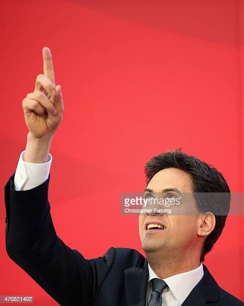 Labour Party leader Ed Miliband points to members of the audience high up on abalcony before a speech on the Party's NHS rescue plan at the Brooks...