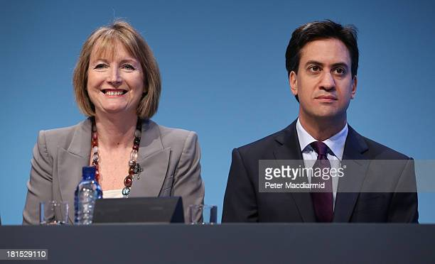 Labour party leader Ed Miliband sits next to deputy party leader Harriet Harman at the Labour Party conference on September 22 2013 in Brighton...