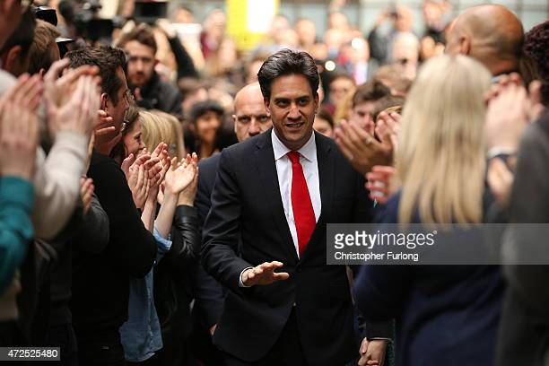 Labour Party leader Ed Miliband waves as he arrives at Labour party headquarters on May 8 2015 in London England After the United Kingdom went to the...