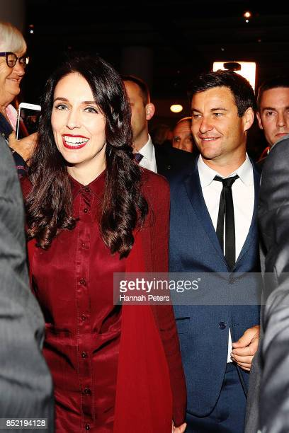 Labour Party leader Jacinda Ardern arrives with her partner Clarke Gayford at the Labour Party election party on September 23 2017 in Auckland New...