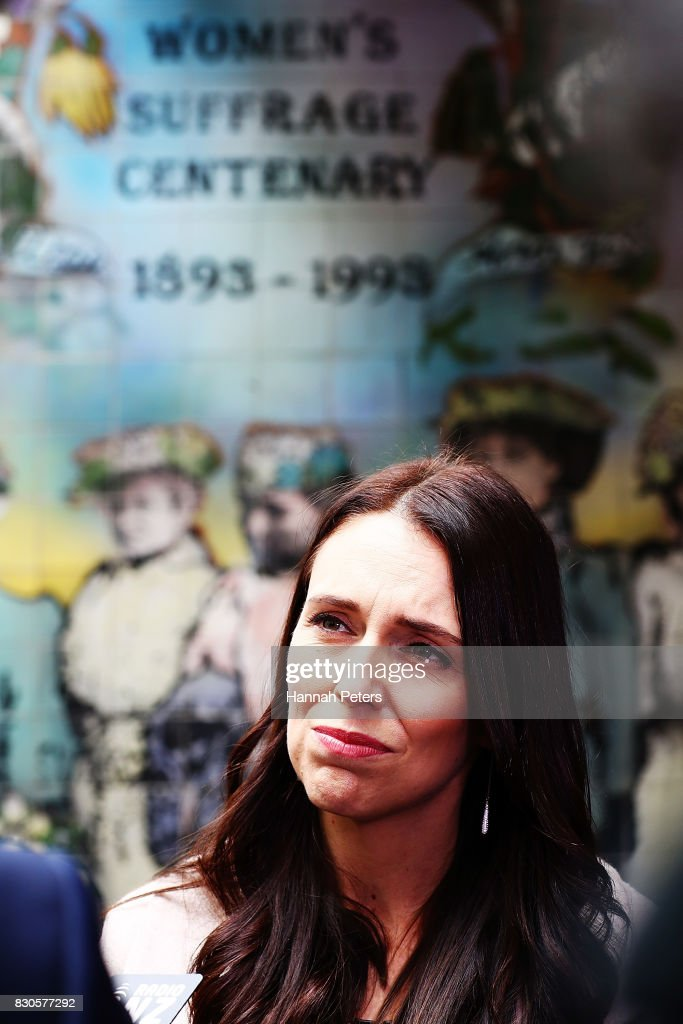 Labour Party leader Jacinda Ardern is interviewed in front of the Women's Suffrage Centenary wall during a rally for pay equity in New Zealand on August 12, 2017 in Auckland, New Zealand. Opposition MPs and members of the public are protesting against the government's Pay Equity Bill ahead of its anticipated first reading in parliament on Tuesday.